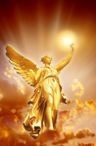 gold angel with divine Light over beautiful mystical sky