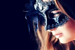 17621026 - portrait of a beautiful young woman in a carnival mask. over black background.