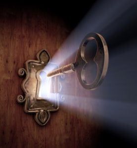7059069 - a close-up of a key moving towards the key hole.